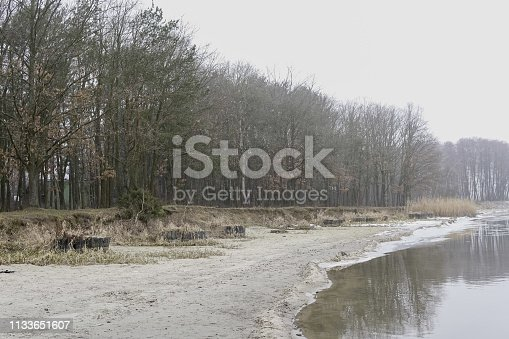 istock shore of a lake covered with ice 1133651607