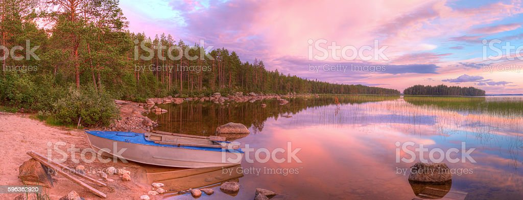 Shore of lake with boat and beautiful sky in evening royalty-free stock photo