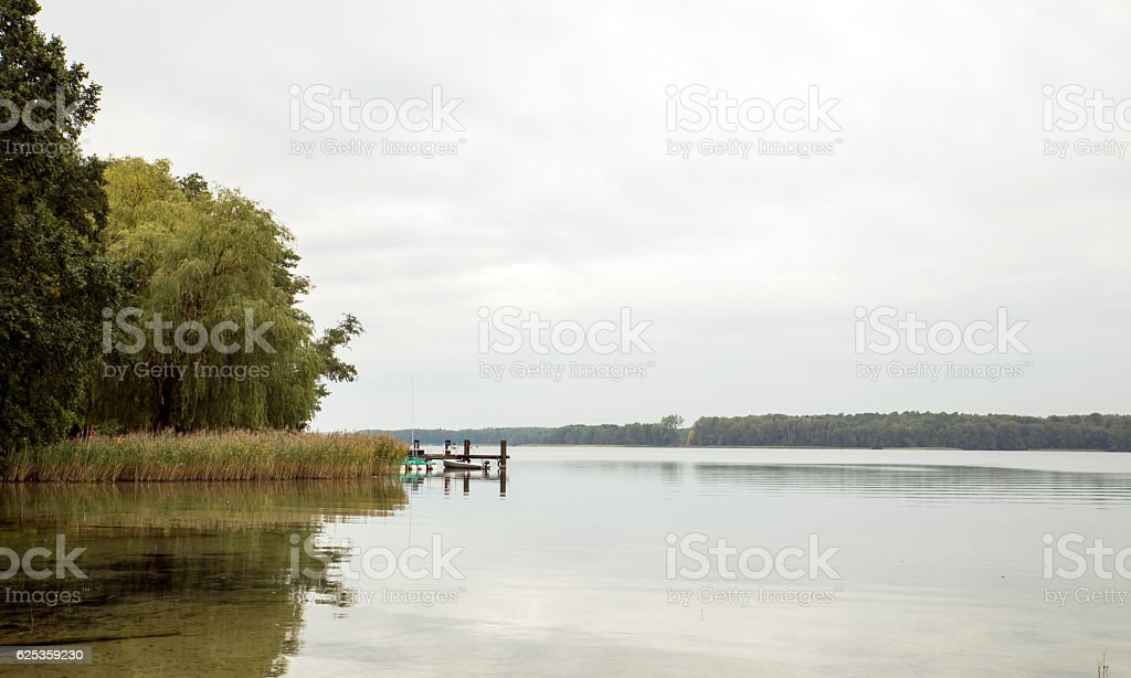 shore with landing stage and boots on the werbellinsee stock photo