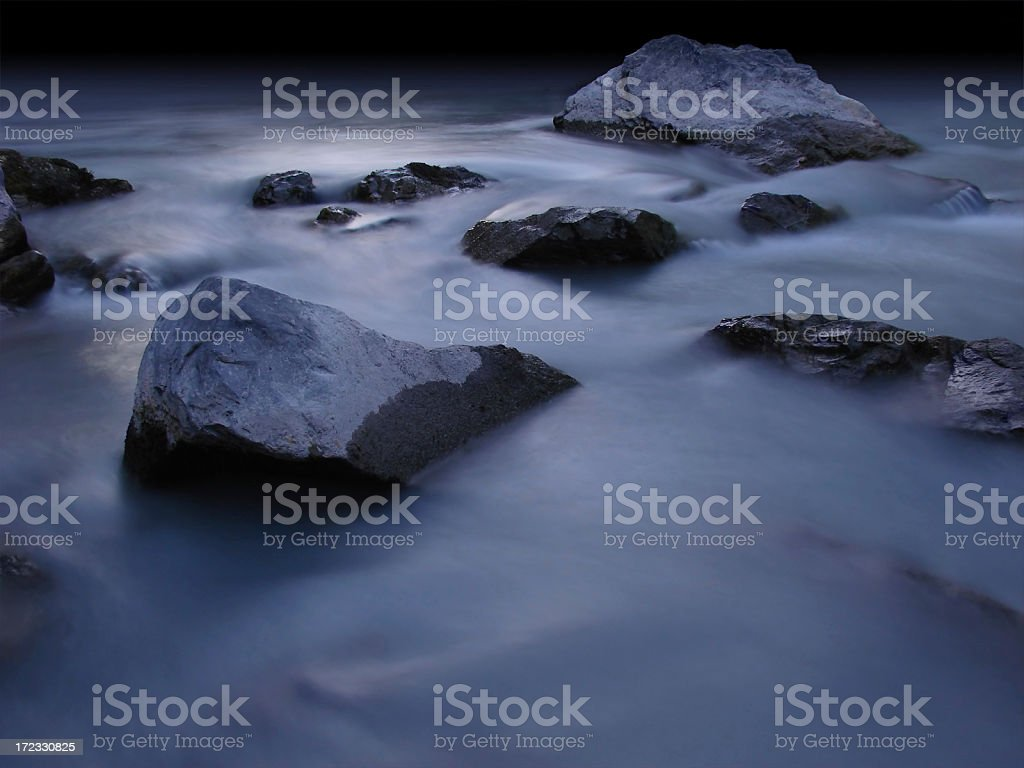 shore with rocks at night in silver moonlight royalty-free stock photo
