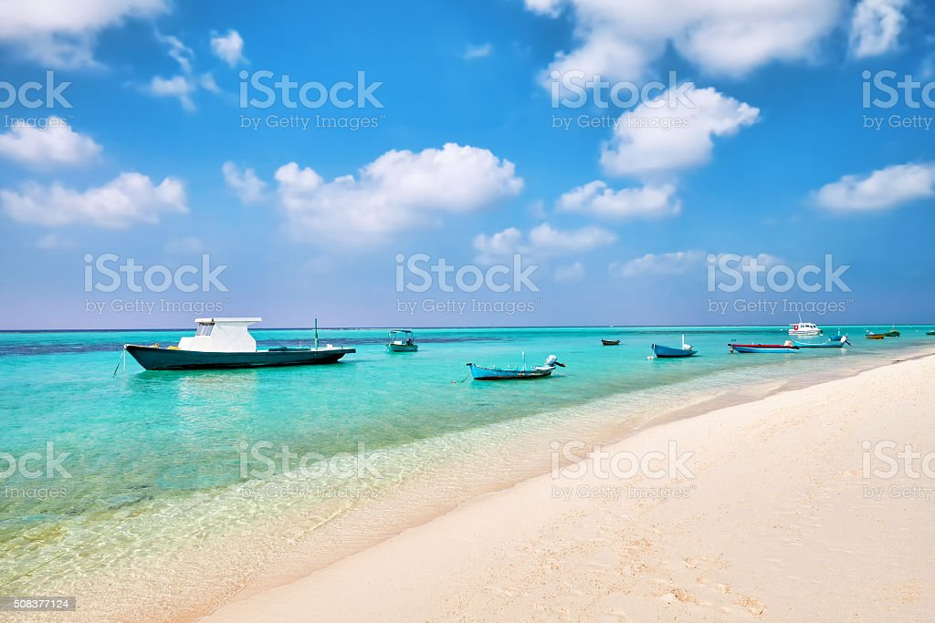 Shoreline of a tropical island with boat in the Maldives stock photo