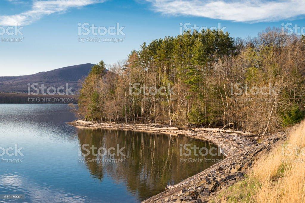 Shoreline of the Ashokan Reservoir taken during the golden hour. stock photo