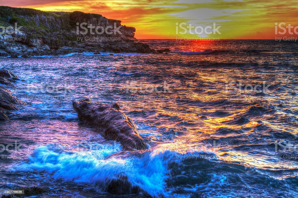 shoreline on a colorful sunset stock photo