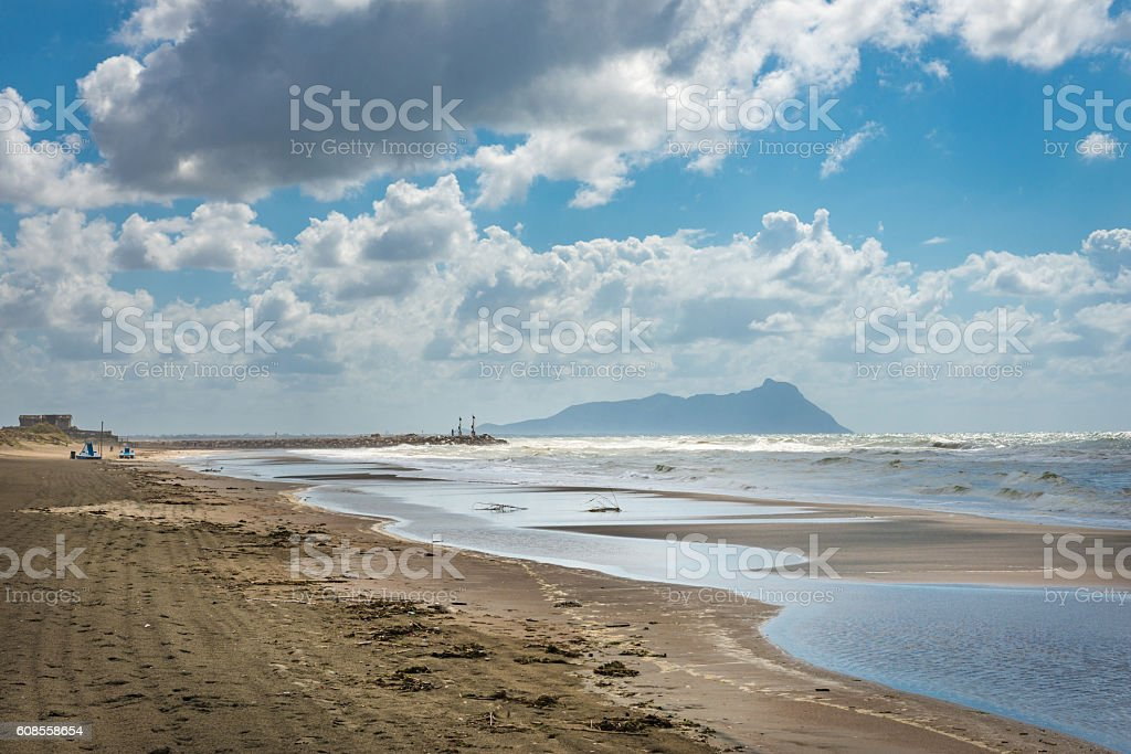 Shoreline under a cloudy sky stock photo