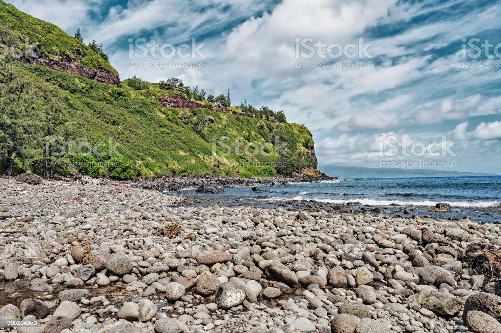 Shoreline View Honoko Hall beach from below with Rocks royalty-free stock photo