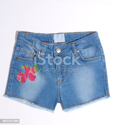 One short blue jeans isolated on white