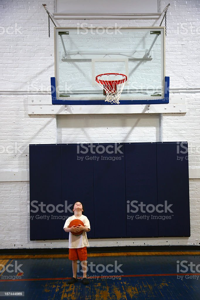 Short Boy Tall Basket royalty-free stock photo