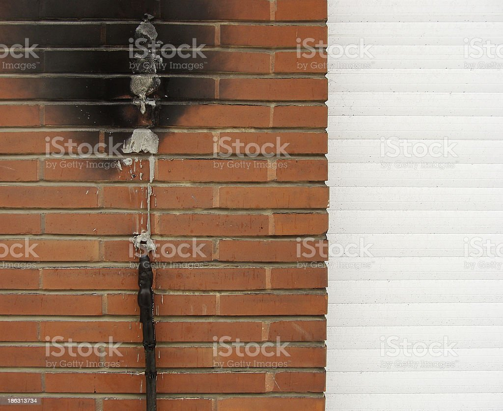 short circuit fire damage on a brick wall royalty-free stock photo