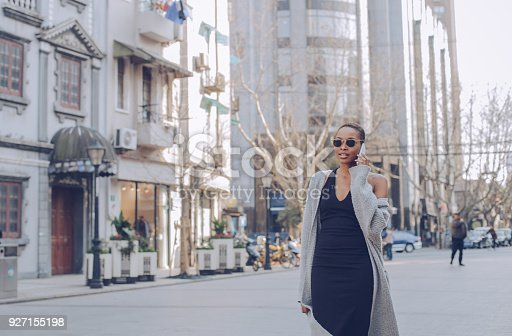 909457386istockphoto Short hair girl talking on mobile 927155198