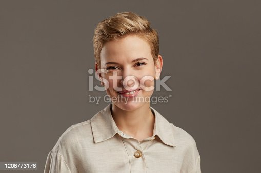 610678842 istock photo Short Haired Young Woman on Grey 1208773176