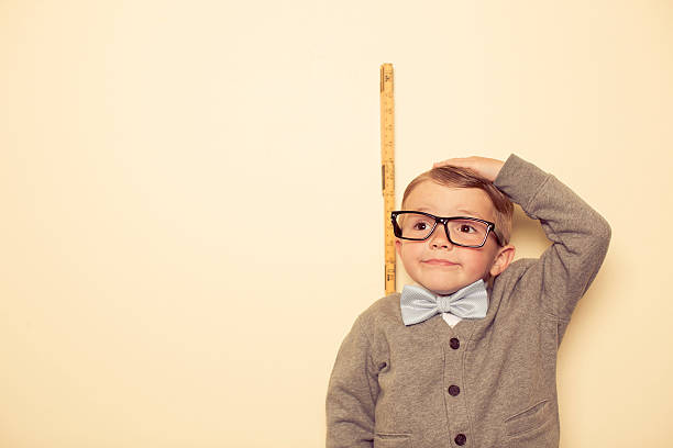 short male nerd - measuring stock photos and pictures