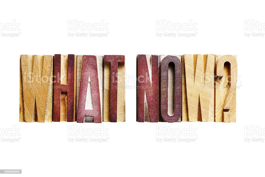 WHAT NOW? short phrase old letterpress printing blocks stock photo
