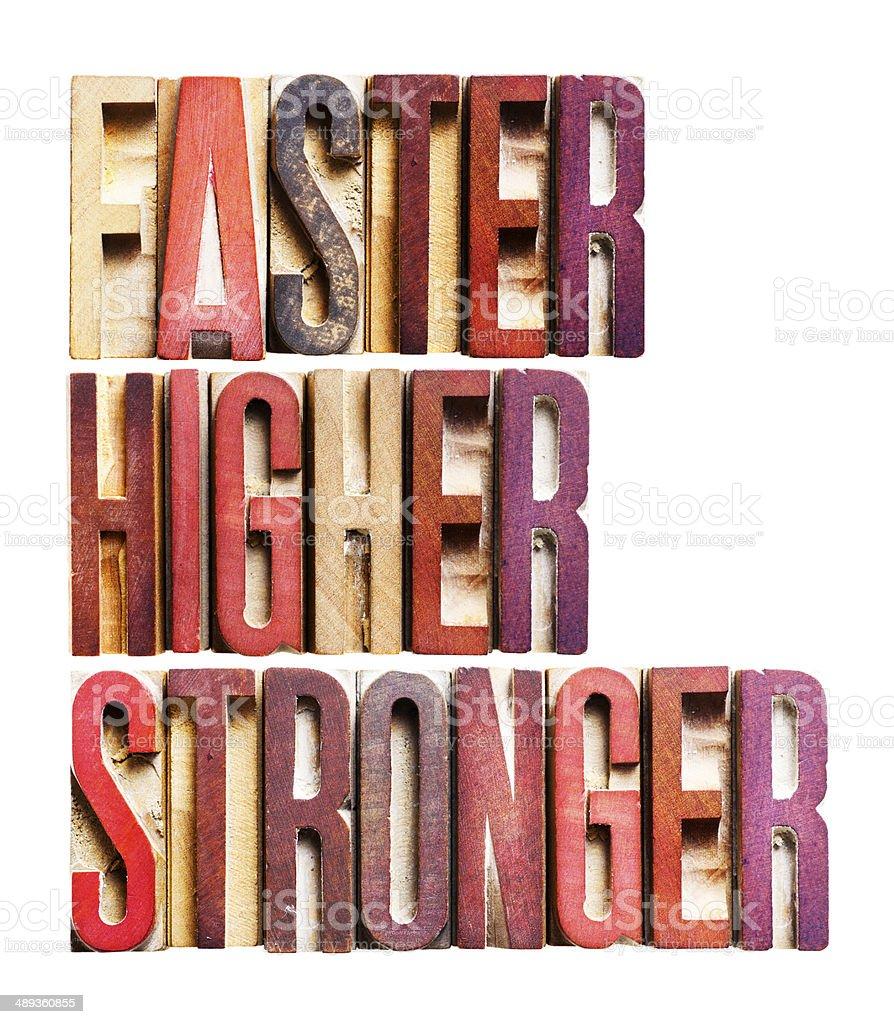 FASTER HIGHER STRONGER- short phrase-old letterpress printing blocks stock photo
