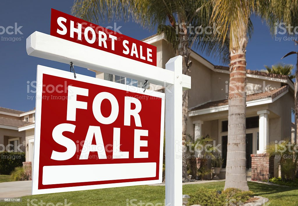 Short Sale Real Estate Sign and House - Left royalty-free stock photo