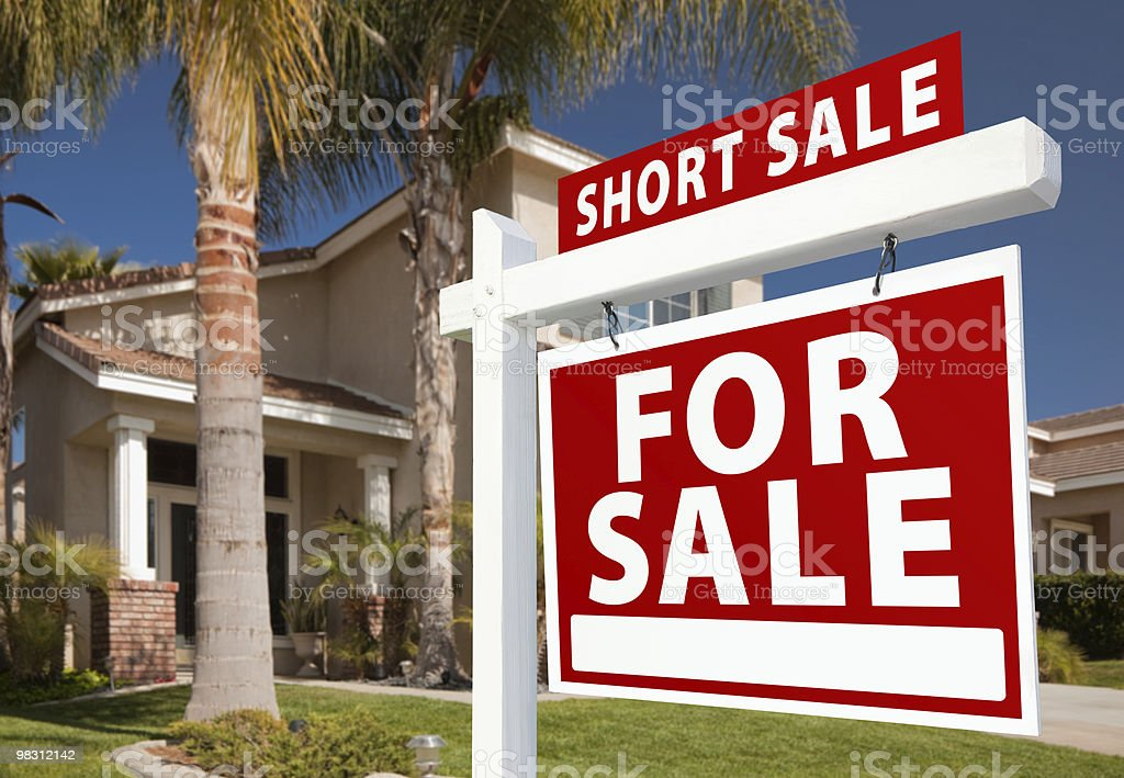 Short Sale Real Estate Sign and House - Right royalty-free stock photo