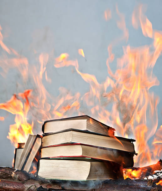 short stack of books ablaze  ablaze stock pictures, royalty-free photos & images