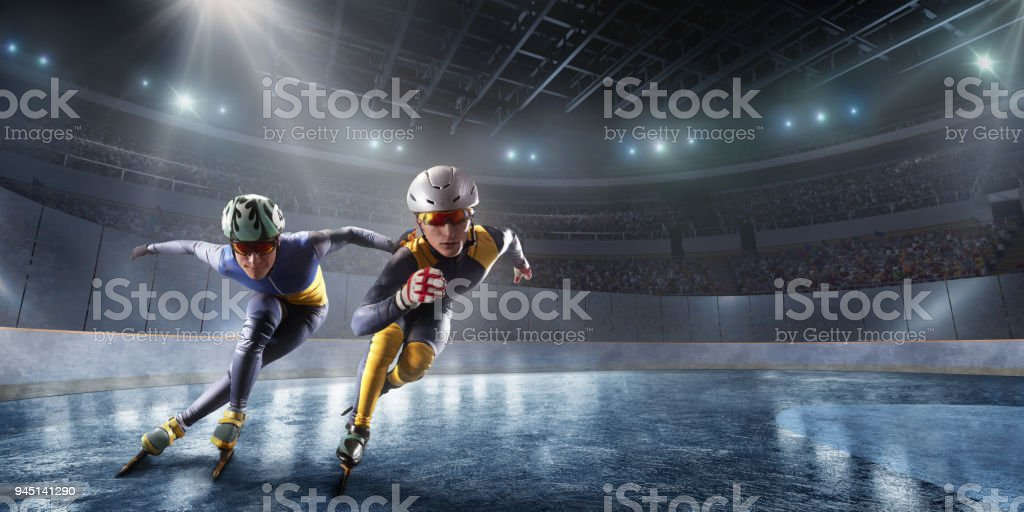 Short Track athletes slide in professional ice arena. Fall of a skater stock photo