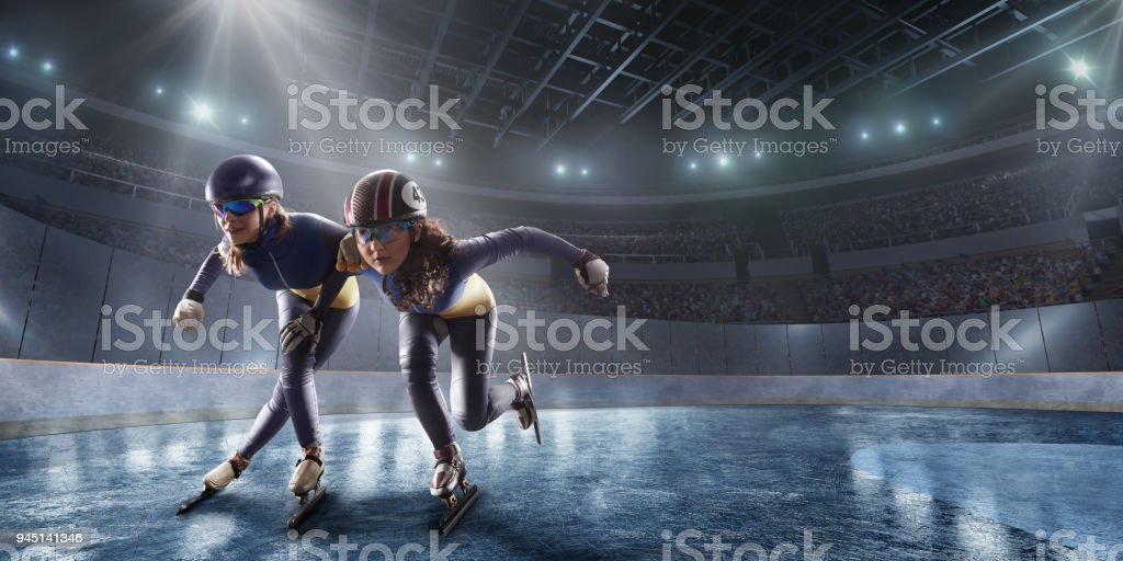 Short Track athletes slide in professional ice arena stock photo