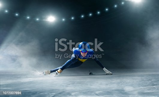 Short track speed skater in ice arena