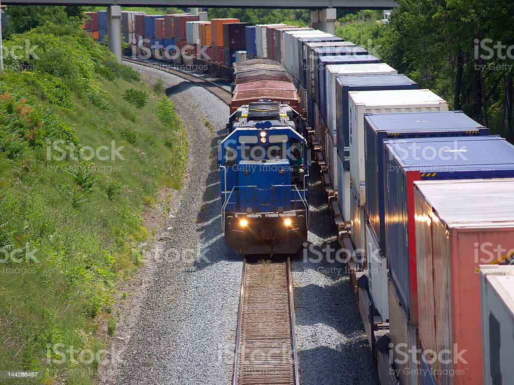 Short train beside long one stock photo