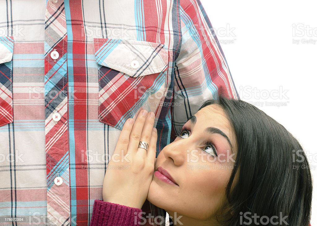 A short woman looking up at her tall boyfriend stock photo