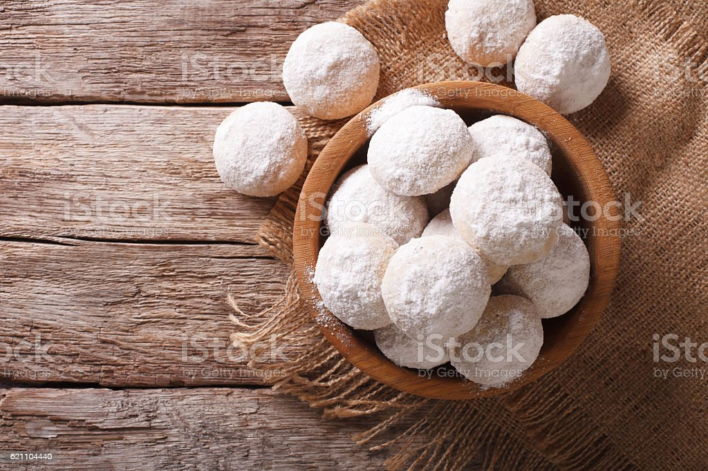 Shortbread polvoron in a wooden bowl. Horizontal top view stock photo
