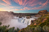 The sky lights up at sunset over Shoshone Falls in Idaho. Shoshone Falls is considered the Niagara of the West.