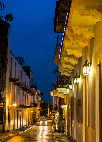 Shot at night, Casco Viejo also called Casco Antiguo, Panama City's Old Quarter established in 1673, with its old buildings, a taxi unrecognizable persons in background.