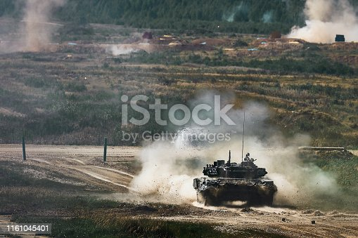 Shot from a tank. Russian tank shot on range. Smoke, explosions, military