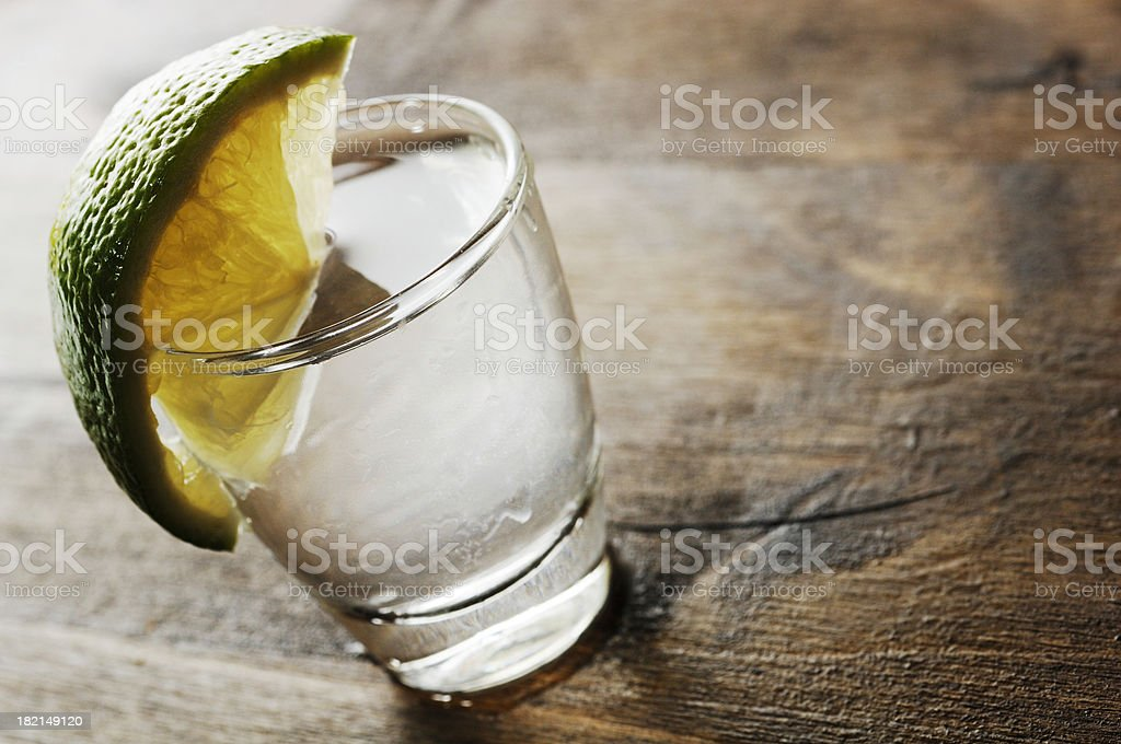 shot glass filled with clear alcohol stock photo