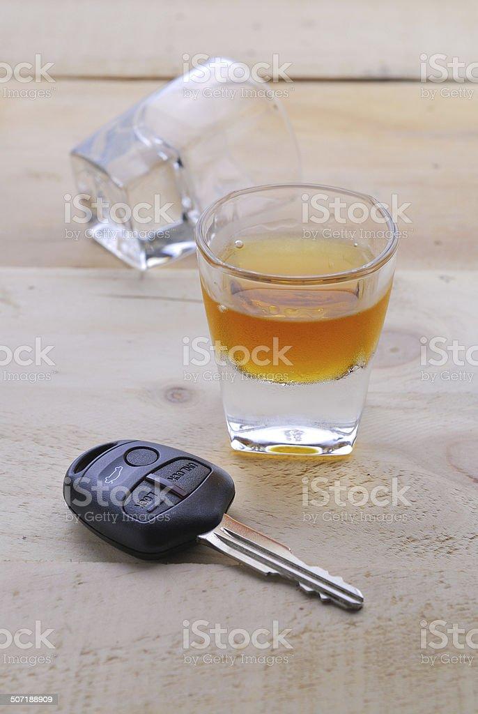 Shot glass with car keys stock photo