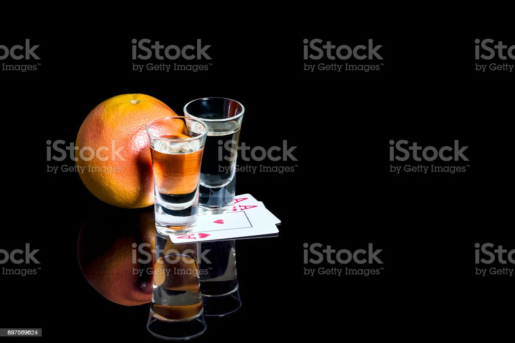 Shot glasses of tequila with cards and Mandarin stock photo