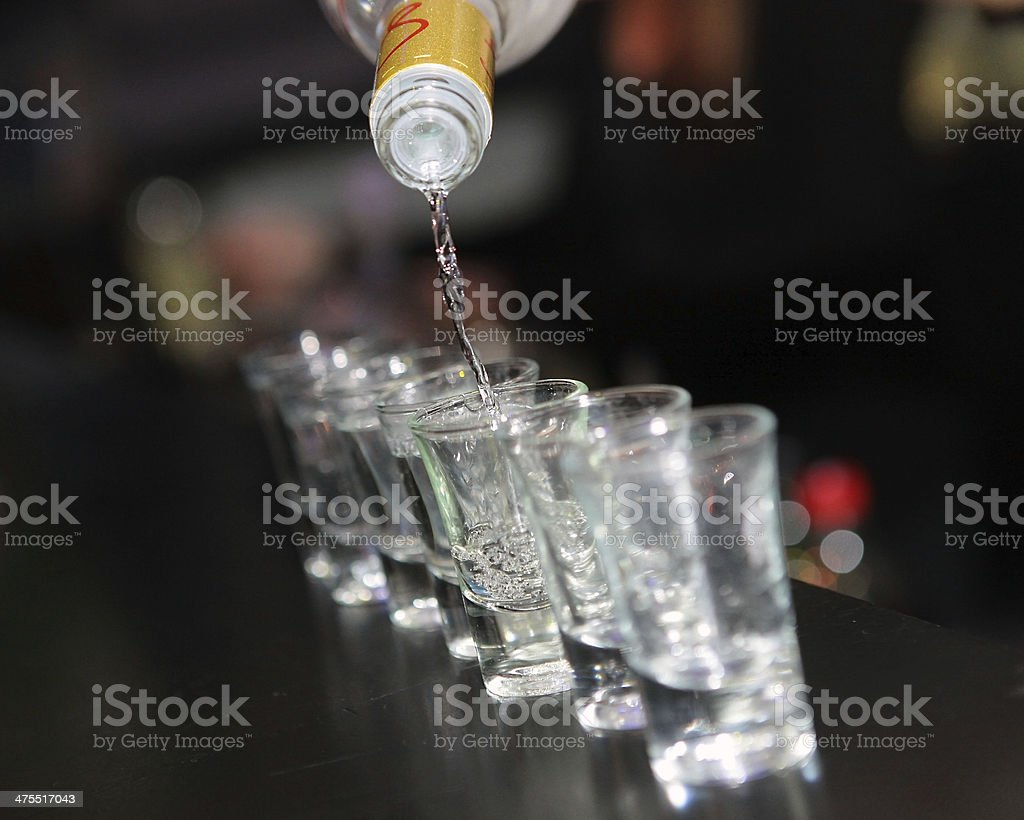shot glasses of vodka on the bar counter stock photo
