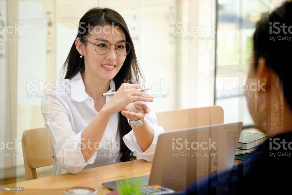 Shot of a asian young businesswoman working on her laptop in the office. royalty-free stock photo
