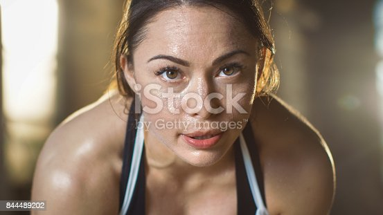 istock Shot of a Beautiful Athletic Brunette Resting on the Bench and Smiling into the Camera. 844489202
