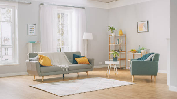 Shot of a Bright Cozy Modern Apartment with Big Windows, Decorations and Stylish Furniture. Shot of a Bright Cozy Modern Apartment with Big Windows, Decorations and Stylish Furniture. home interior stock pictures, royalty-free photos & images