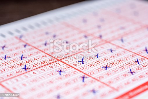 istock Shot of a completed lottery ticket 973200042