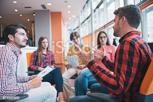 istock Shot of a group of young business professionals having a meeting. 674302944