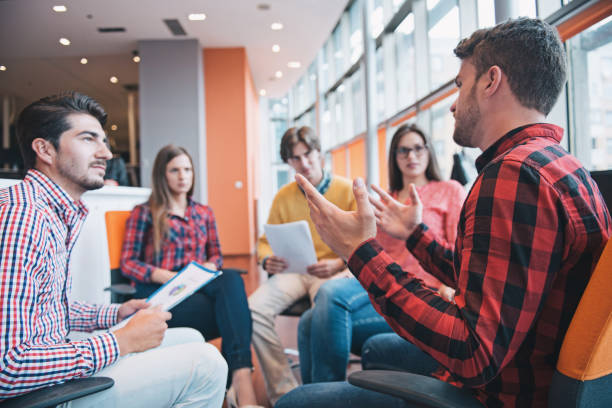 shot of a group of young business professionals having a meeting. - casual clothing stock photos and pictures