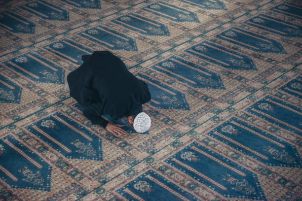 Shot of a Muslim young man worshiping in a mosque