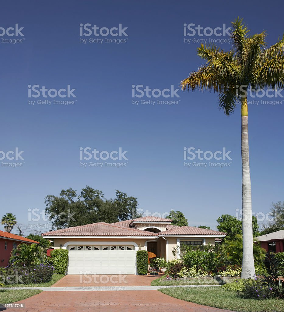 Shot of a plain family house with tree in front royalty-free stock photo