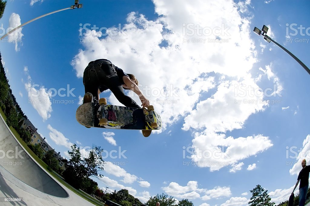 Shot of a skateboard trick catching air stock photo