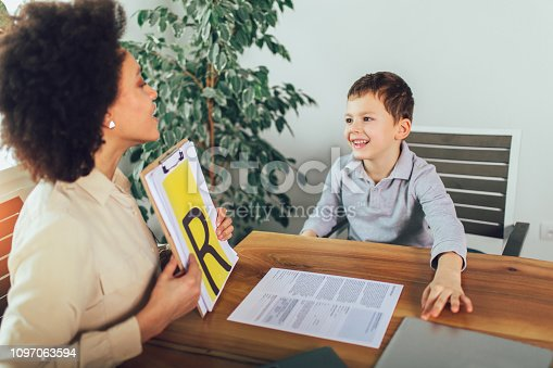 843899350istockphoto Shot of a speech therapist during a session with a little boy 1097063594