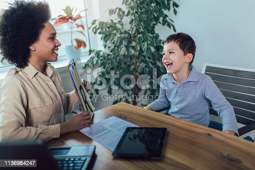 843899350istockphoto Shot of a speech therapist during a session with a little boy 1136984247