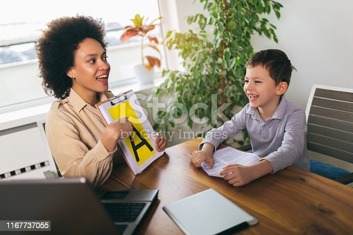 843899350istockphoto Shot of a speech therapist during a session with a little boy 1167737055