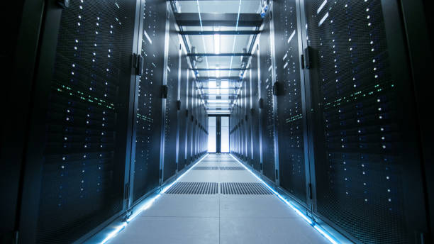shot of a working data center with rows of rack servers. - network server stock pictures, royalty-free photos & images