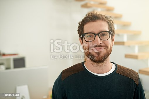 Portrait of a confident young entrepreneur standing in his office