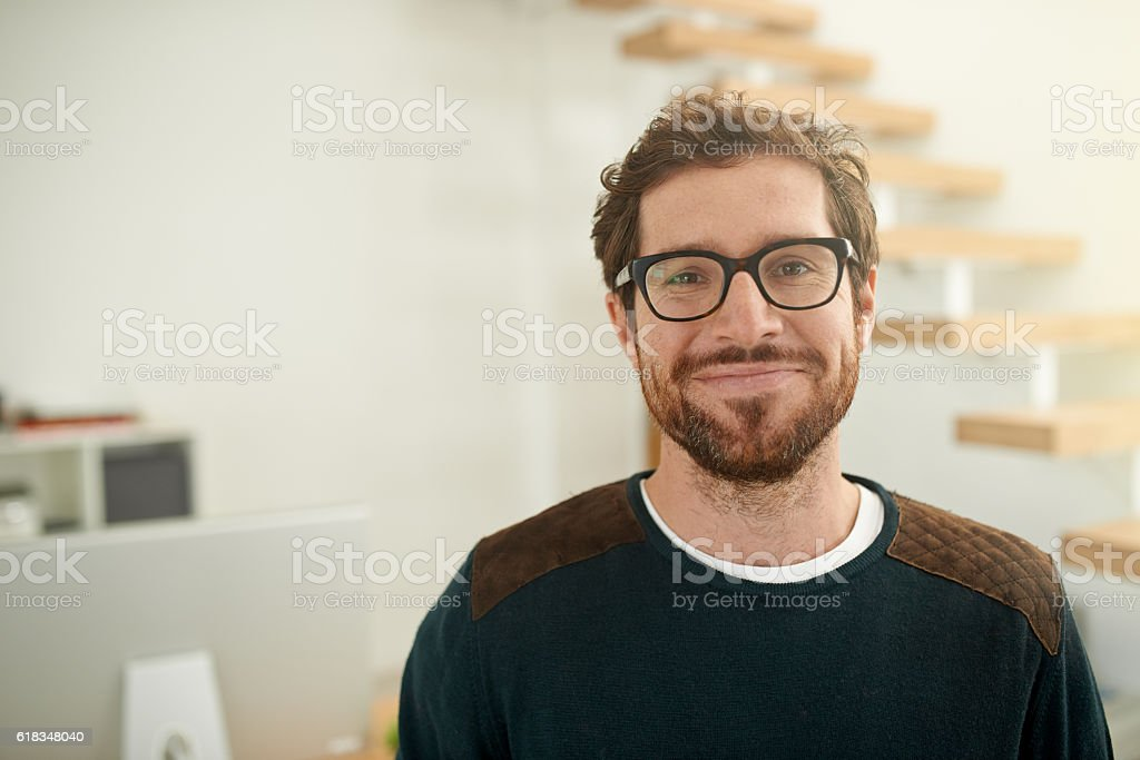 Shot of a young entrepreneur using a mobile phone stock photo