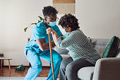 istock Shot of a young male nurse helping an elderly patient stand 1316049546