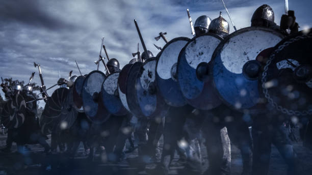 shot of advancing army of viking warriors. medieval reenactment. - warrior person stock pictures, royalty-free photos & images
